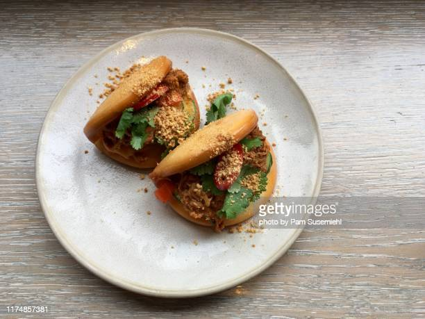 two pork bao buns - bun stock pictures, royalty-free photos & images