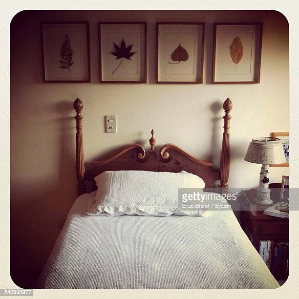 Two Poster Bed In Bedroom At Home