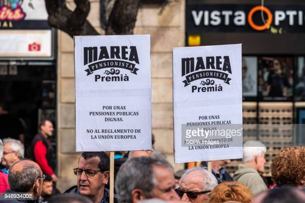Two posters in defense of decent pensions are seen among the crowd of protesters Hundreds of retirees and pensioners have demonstrated in the streets...