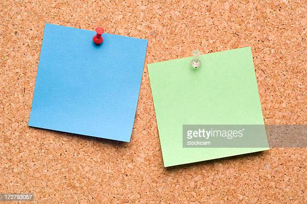 Two Post-it Notes on cork