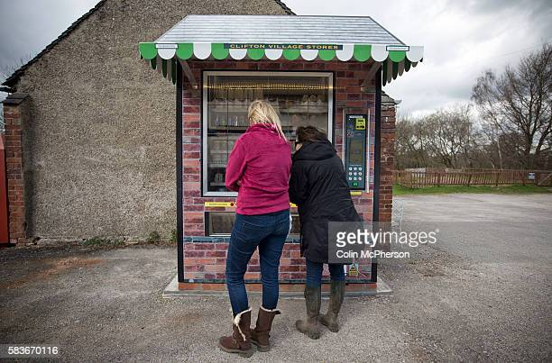 Two potential customers looking at items in the giant vending machine designed and installed by local businessman Peter Fox in the tiny Derbyshire...