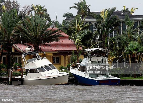 Two power boats are seen washed up on shore after Hurricane Wilma arrived this morning October 24 2005 in Naples Florida Wilma slammed into the South...