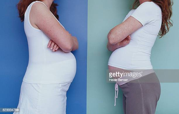 two pregnant women facing each other