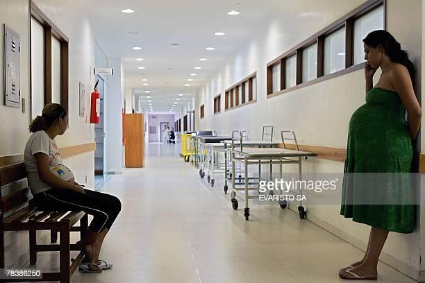 Two pregnant women wait to see a doctor at Brasilia's Children's Hospital 11 December 2007 in Brasilia Brazil President Luiz Inacio Lula da Silva's...