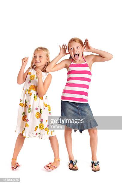 Two Preteen Adolescent Girls in Playful Poses on White Background