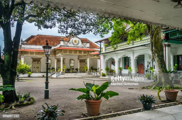 two prominent palatial buildings of javanese architecture, influenced by dutch colonial style, gedong jene, also known as the yellow building and gedong purworetno at the kraton ngayogyakarta hadiningrat, the palace of the yogyakarta sultanate - kraton stock pictures, royalty-free photos & images