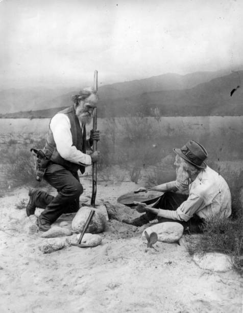 Two prospectors panning for gold in California.