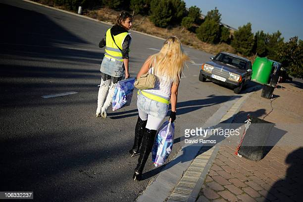 Two prostitutes wear reflective vests as they walk along a road on October 28 2010 near Els Alamus in Lleida Spain Prostitutes working near a highway...