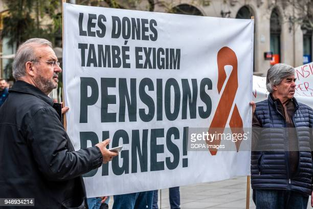 Two protesters are seen with a large banner with the text 'Women also demand decent pensions' Hundreds of retirees and pensioners have demonstrated...