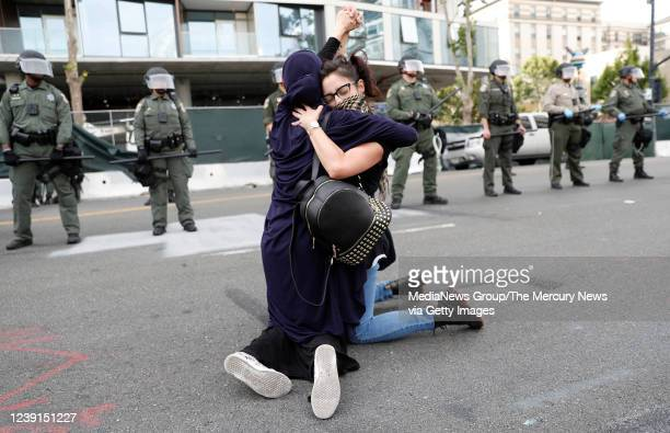 Two protesters hug during a protest of the killing of George Floyd outside of San Jose City Hall in downtown San Jose Calif on Sunday May 31 2020