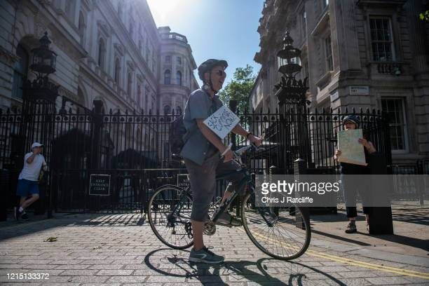 Two protesters outside the gates of Downing Street call for Dominic Cummings special advisor to the prime minister to resign or be sacked whilst Mr...