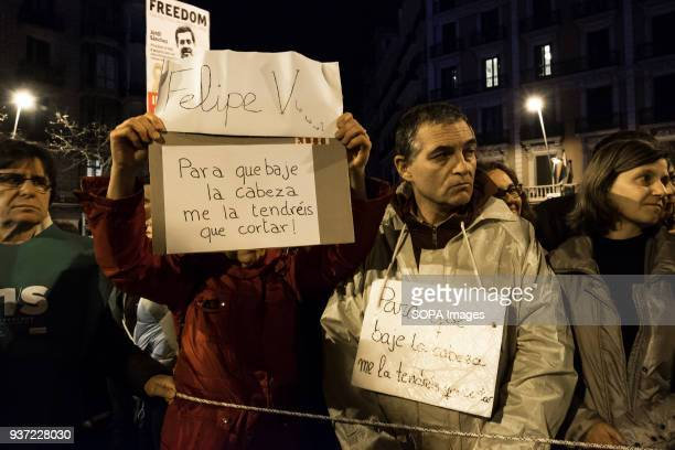 Two protesters seen displaying posters in relation to Felipe VI A few hours after the new sentence of preventive detention for the members of the...