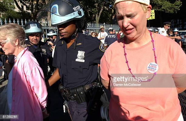 Two protesters with the War Resisters League are arrested at the corner of Fulton and Church Streets as they attempted to march from Ground Zero to...