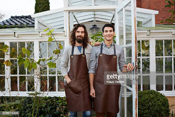 Two proud entrepreneurs in front of greenhouse