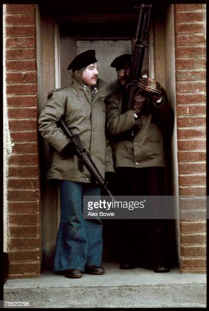 Two Provisional IRA gunmen wearing stockings over their faces for disguise in a doorway on the republican Creggan estate in Londonderry 30th January...