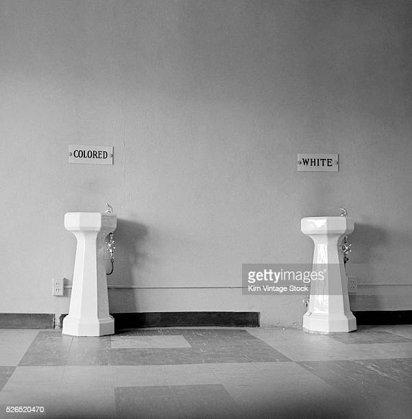 Two public drinking fountains for AfricanAmericans and Caucasians are shown in a picture taken from the photo album of a German tourist who had...