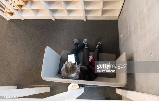 Two pupils are working on their tablets at the comprehensive school in Wutoeschingen Germany 7 December 2016 Every pupil of the Alemannen school has...