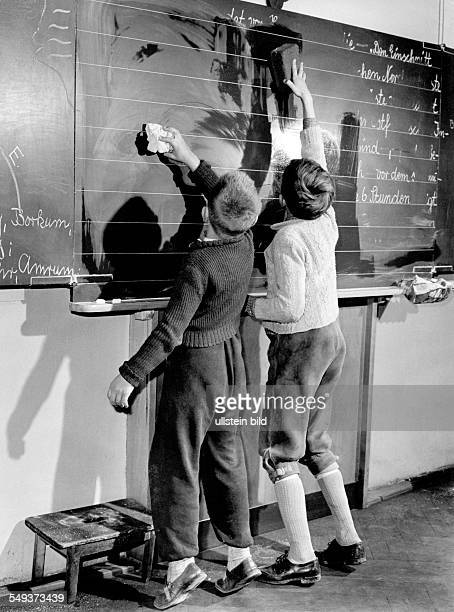 two pupils cleaning the blckboard 1955
