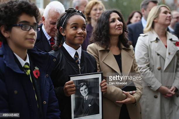 Two pupils from St Clement Danes Schools Omar ait el Caid and Amina Douglas watch with others as the former leader of the Labour Party Neil Kinnock...