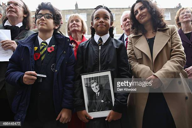 Two pupils from St Clement Danes Schools Omar ait el Caid and Amina Douglas watch the former leader of the Labour Party Neil Kinnock unveil an...