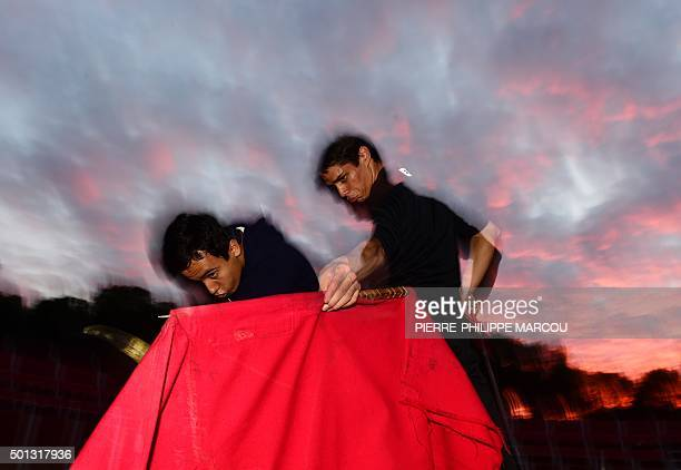 Two pupils practice with a small red cape or muleta and bull's horns during an open air class at Marcial Lalanda bullfighting academy in Madrid's...