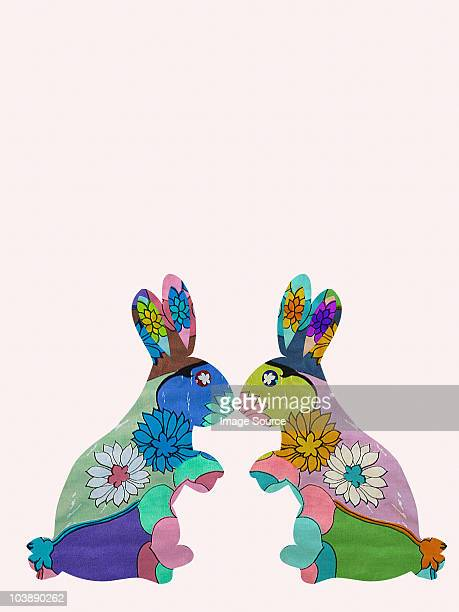 Two rabbits, face to face