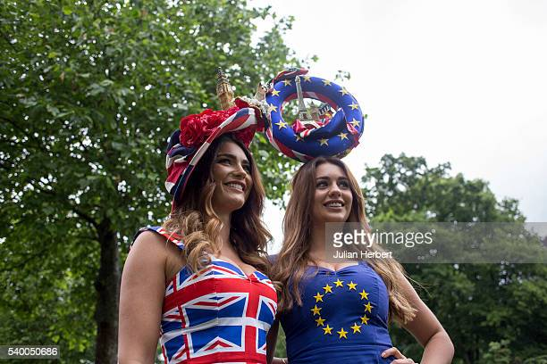 Two racegoers arrive on Day One of Royal Ascot at Ascot Racecourse on June 14 2016 in Ascot England