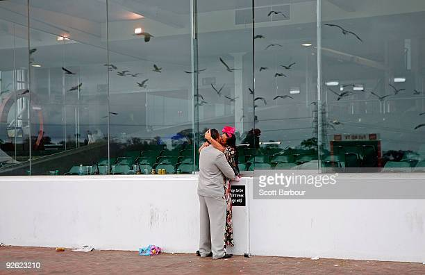 Two racegoers embrace as they make their way home after the 2009 Melbourne Cup Day meeting at Flemington Racecourse on November 3 2009 in Melbourne...
