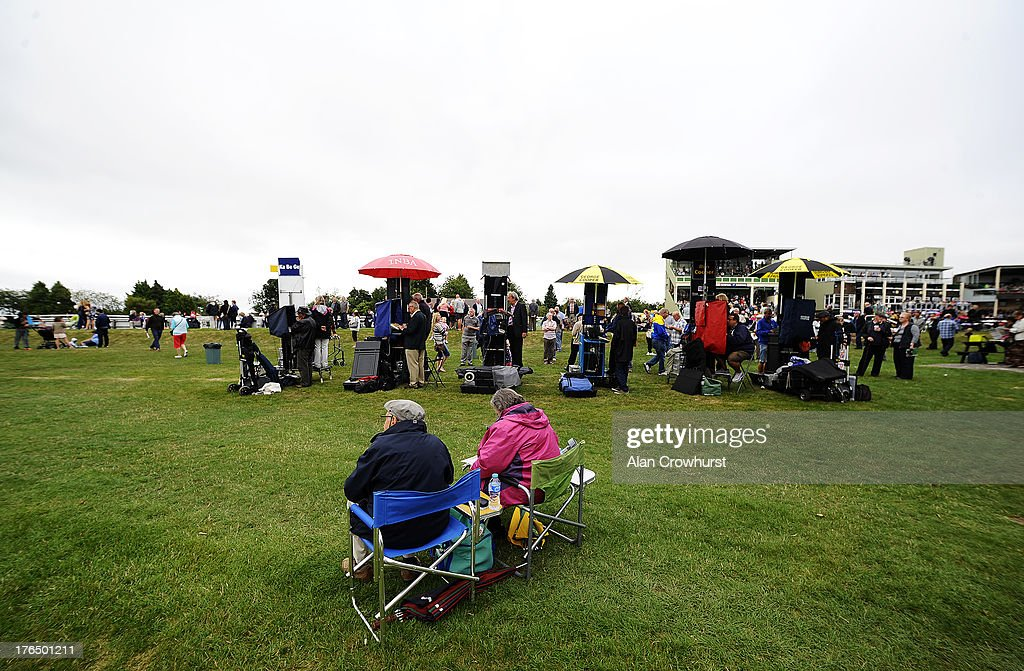 Two racegoers relax near the bookmakers at Salisbury racecourse on August 14, 2013 in Salisbury, England.