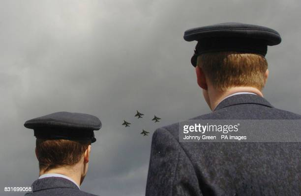 Two RAF servicemen watch four SEPECAT Jaguar GR3 aircraft take off from RAF Coltishall in Norfolk, Saturday April 1, 2006. The aircrafts are the last...