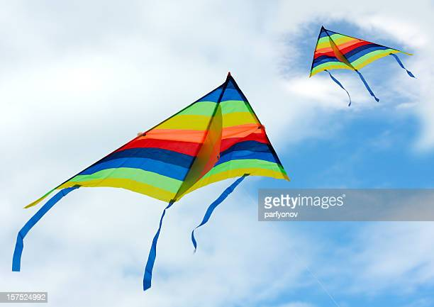 Two rainbow kites flying in the sky