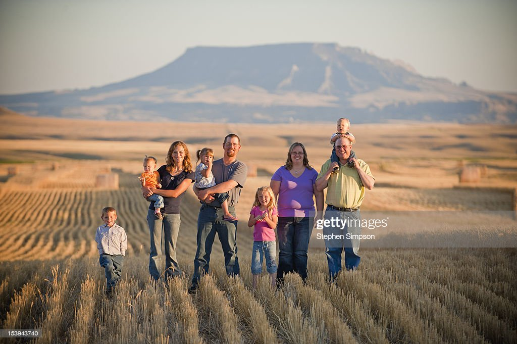 two ranch/farm families pose in wheat field : Stock Photo