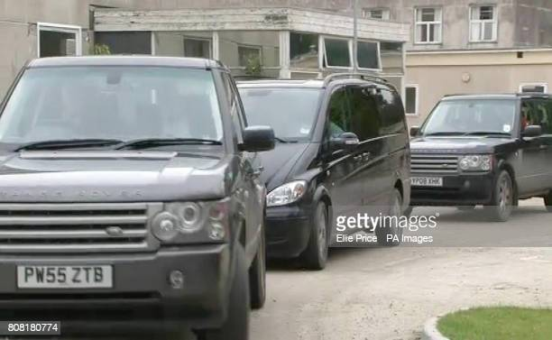 Two Range Rovers and a People Carrier with blackout windows carrying Prime Minster David Cameron and wife Samantha with newborn baby Florence are...