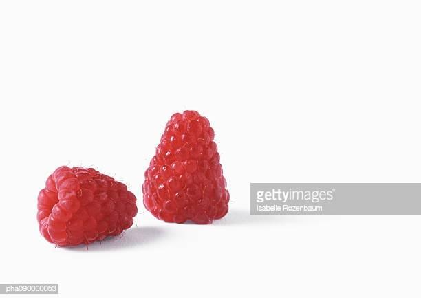 Two raspberries, white background