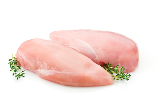 Two raw chicken breast on white backdrop 93456470