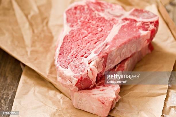 Two Raw T Bone Steaks