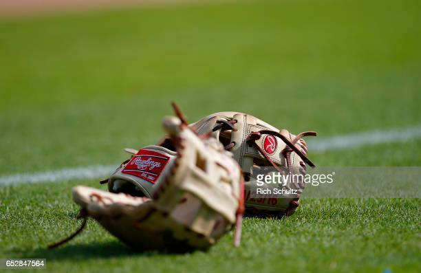 Two Rawlings baseball gloves belonging to the Washington nationals sit on the field before a spring training baseball game against the Houston Astros...