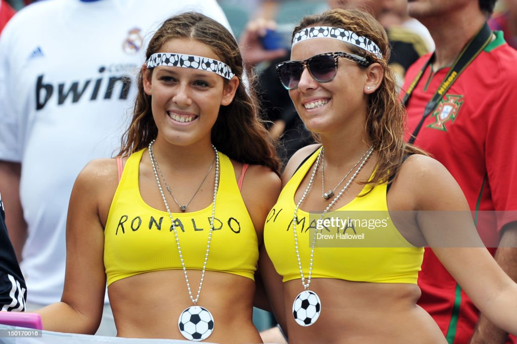 Two Real Madrid fans wait for the game to start against Celtic at Lincoln Financial Field on August 11, 2012 in Philadelphia, Pennsylvania.