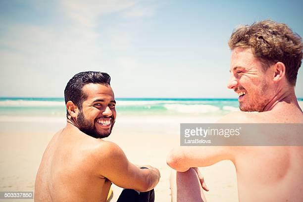 Two real mixed race friends at Bondi Beach, Australia