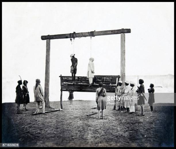Two rebels hanging from a gallows where they were executed following the British suppression of the Indian Rebellion of 1857 Lucknow Uttar Pradesh...