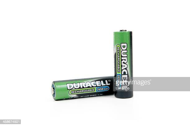 two rechargeable aa duracell batteries - duracell stock pictures, royalty-free photos & images