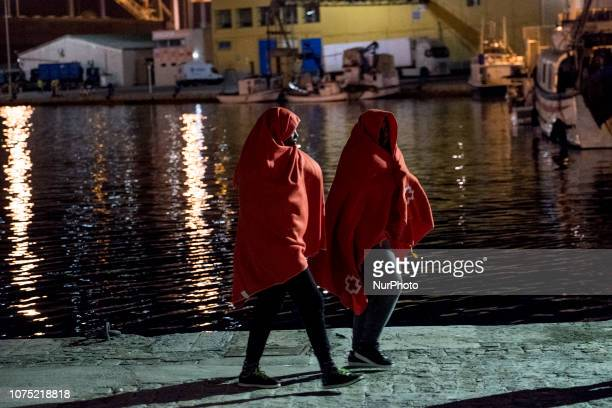 Two recued female migrants waking towards the Care Unit at the Malaga port on 22 December 2018 in Malaga Spain 120 migrants were recued from the...