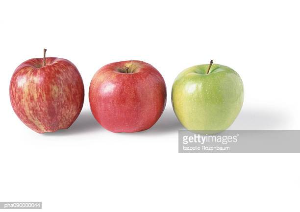 Two red apples and a green apple, white background