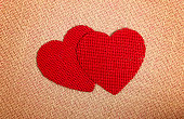 two red burlap love hearts brown