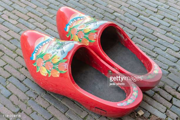 two red colored dutch giant wooden shoes - clogs stock pictures, royalty-free photos & images