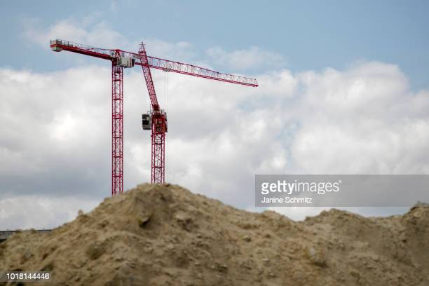 BERLIN GERMANY AUGUST Two red Cranes for house construction are pictured on August 10 2018 in Berlin Germany