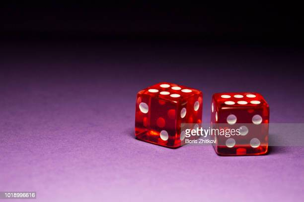 two red dice. - dice stock pictures, royalty-free photos & images