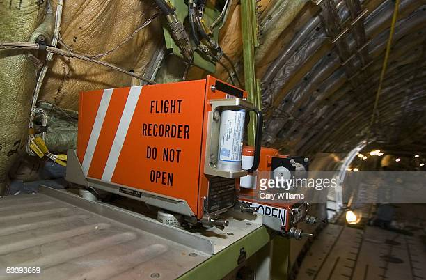 Two red flight recorders or 'Black Boxes' lie on a shelf located in the tail section of a 747 cargo plane at the Evergreen Air Center August 15 2005...