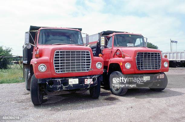 Two red Ford dumper trucks in USA 2000