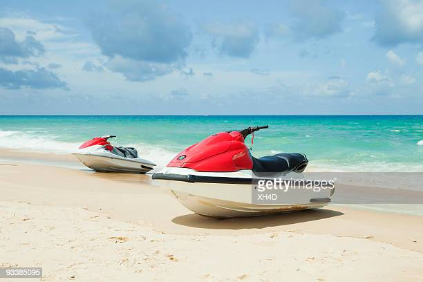 Two red motorboat in the beach